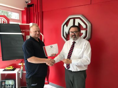 Ian Gets MG Accreditation
